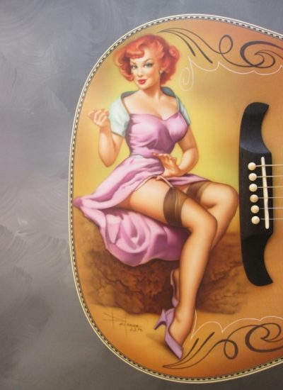 16. pin up on guitar