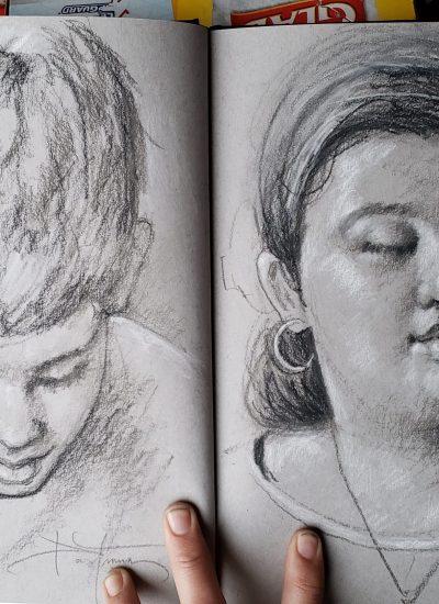 20. pair of kids portraits on sketchbook charcoal