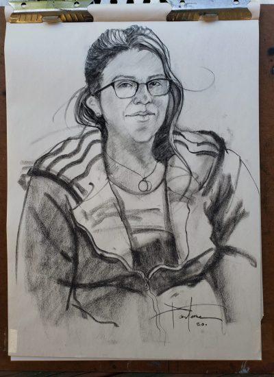 50. charcoal sketch woman sitting