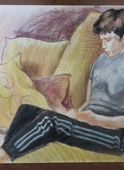 62. boy reading pastels
